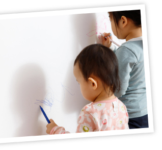 Kids painting on walls