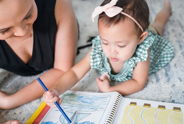 Preschool in Singapore: Mom teaching child coloring