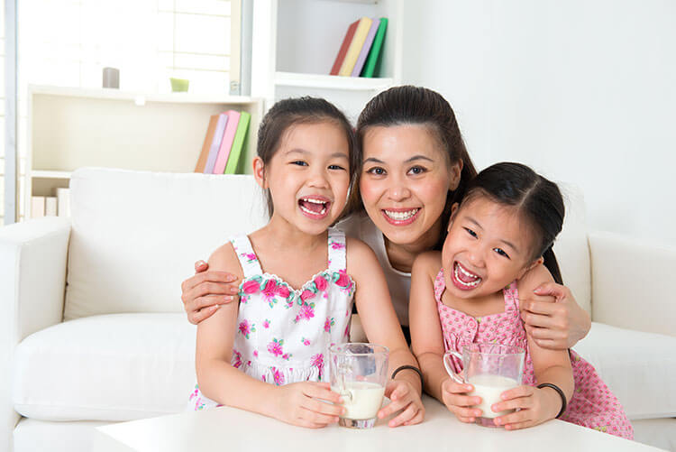 happy mother & children with formula milk